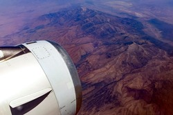 Aerial view of rugged American Southwest with plane engine.