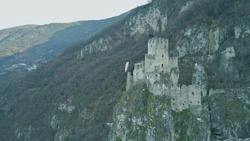 Aerial view of ruined medieval Haderburg Castle in Salorno, Italy