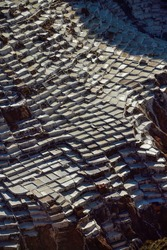 Aerial view of salt mines in Maras in Sacred Valley, the former center of Inca empire, Peru