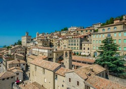 Aerial view of San Marino old town. With buildings and red roofs on the hill on a sunny day