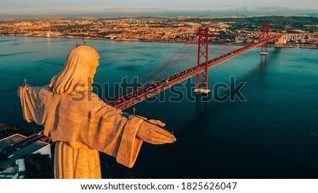Aerial view of Sanctuary of Christ the King, Santuario de Cristo Rei. Lisbon, Portugal. Drone photo at sunrise. Catholic monument