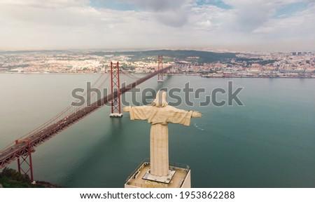 Aerial view of Sanctuary of Christ the King, Santuario de Cristo Rei. Lisbon, Portugal. Drone photo at sunrise. Catholic monument Stockfoto ©