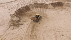 Aerial view of sand quarry with bulldozer