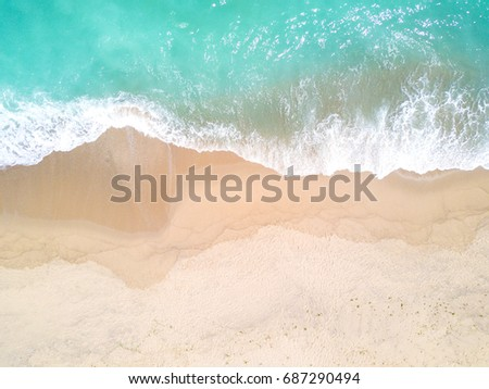 Aerial view of sandy beach and ocean with waves #687290494
