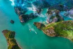 Aerial view of Sang cave and Kayaking area rock island, Halong Bay, Vietnam, Southeast Asia.UNESCO World Heritage Site. Junk boat cruise to Ha Long Bay. Popular landmark, famous destination of Vietnam