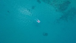 Aerial view of sculler in open water. Ocean and sea travel and transportation