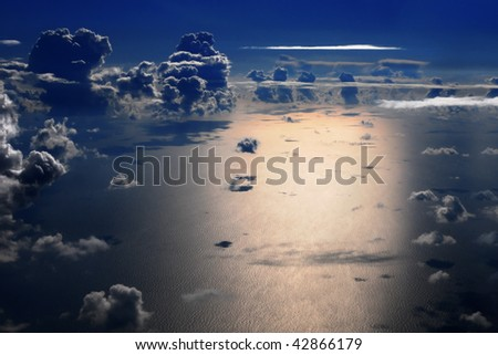Aerial view of sea and cumulus clouds at night