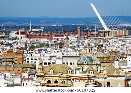 aerial view of Seville, Spain, with Almillo bridge in the background - stock photo