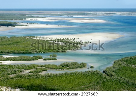 Aerial view of shallow coastal waters and forests of the tropical coast of Mozambique, southern Africa