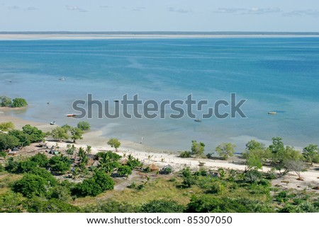 Aerial view of shallow coastal waters and rural settlement on the tropical coast of Mozambique, southern Africa