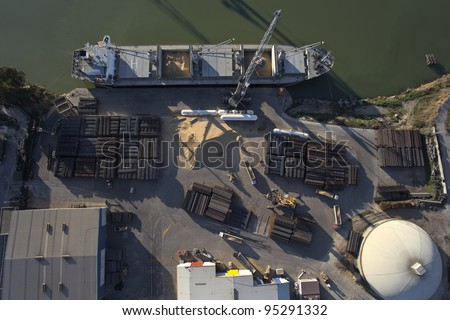 aerial view of ship docked in port loading and unloading