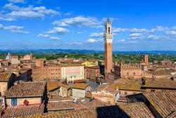 Aerial view of Siena with Campo Square (Piazza del Campo), Palazzo Pubblico and Mangia Tower (Torre del Mangia) in Siena, Tuscany, Italy