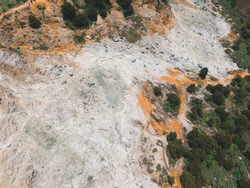 Aerial view of Sikidang crater with the background of sulfur vapor coming out of the sulfur marsh.