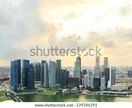 Aerial view of Singapore downtown with moody sunset sky