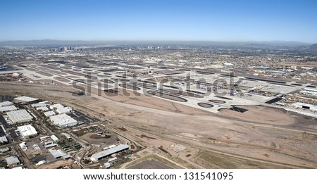 Aerial view of Sky Harbor Airport with the city of Phoenix, Arizona skyline in the distance