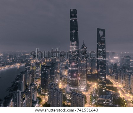 aerial view of skyscrapers at night in Shanghai city