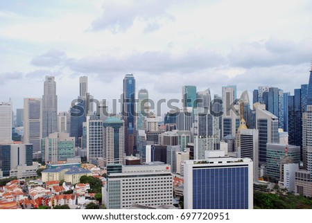 Aerial view of Skyscrapers, Modern city buildings, Chinatown & downtown and Business Center Buildings at Singapore during day time #697720951