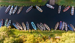 aerial view of small fishing boats in a row on a river canal, Killarney national park, Ireland