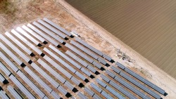 aerial view of solar energy panels and agriculture fields
