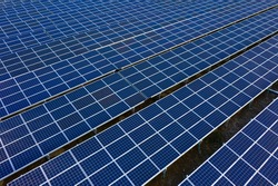 Aerial view of solar panels farm, alternative energy power station
