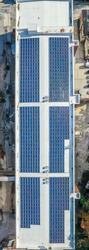 Aerial view of solar panels installed on a former brick factory building that was converted to a fashionable office building in Baltimore Maryland
