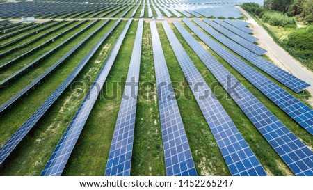 aerial view of solar panels on green lawn. drone shot, bird's eye #1452265247