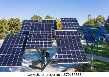 Aerial view of solar panels or solar panels Platform in a city park in Warsaw.  Poland. Photovoltaic solar panels absorb sunlight as an energy source for generating electricity.