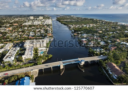 aerial view of southeast florida luxury waterfront community on atlantic intracoastal waterway and ocean - stock photo