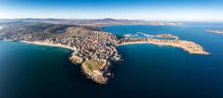 Aerial view of Sozopol town on black sea coast, summer holyday destination with white sand and clear blue water. Historic old town with old buildings.