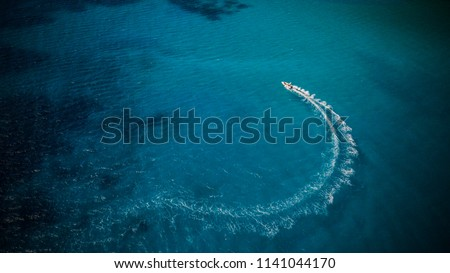 Aerial view of speed boat in motion. Water transportation and summer leisure time activity.