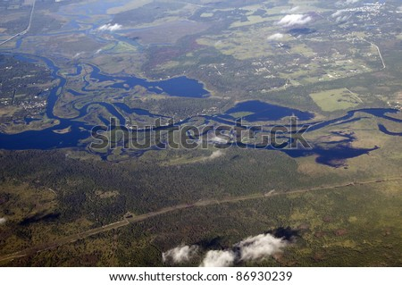 Aerial view of St Johns river winding through central Florida at 30,000 feet