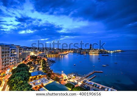Aerial view of St. Julian's bay at the blue hour, Malta