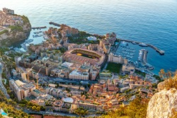 Aerial view of stadium of Monaco at sunrise, view from La Turbie, landmark of Monaco, Monte-Carlo, port Cap Dail, port Fontvieille, Monaco Ville,  blue sea, morning