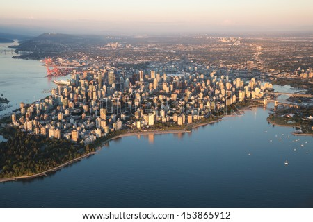 Aerial view of Stanley Park and Downtown Vancouver, BC, Canada. During a hazy sunny sunset. #453865912