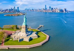 Aerial View of Statue of Liberty, Ellis Island and Lower Manhattan Skyline from New York Harbor near Liberty State Park in New Jersey