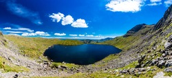 Aerial view of Stickle Tarn lake, the Lake District, Great Langdale valley, Cumbria
