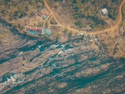 Aerial view of streams from high angle at Sopheakmit Waterfall or Preah Nimith Waterfall in Preah Vihear, Stueng Treng which is located  between Cambodia and Laos. Nature background concept.