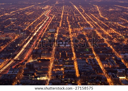 Aerial view of streets through Chicago at night