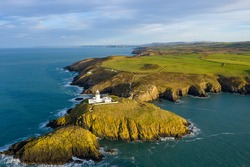 Aerial view of Strumble Head Lighthouse, near Goodwick, Pembrokeshire, Dyfed, Wales, UK