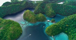 Aerial view of Sugba lagoon. Beautiful landscape with blue sea lagoon, National Park, Siargao Island, Philippines.