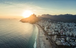 Aerial view of sunset behind the mountains on the beach Rio De Janeiro, Brazil