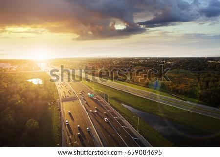 Aerial view of sunset over a highway in Orlando, Florida. #659084695