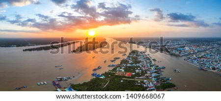 Aerial view of sunset over Mekong river, area of My Tho city, Tien Giang, Vietnam. Mekong Delta. Near Ben Tre