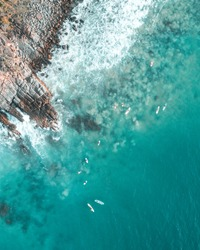 Aerial View of Surfers and Waves