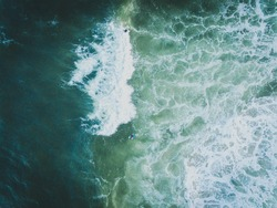 Aerial view of surfers & waves