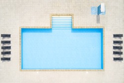 Aerial view of swimming pool outside hotel. Beautiful pool ready to holiday tourists. Top view.