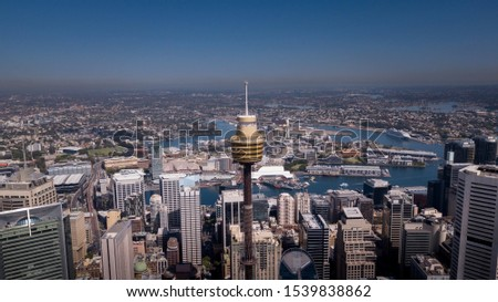 Aerial view of Sydney City Centre during sunny day.Sydney Tower is Sydney's tallest structure and the second tallest observation tower in the Southern Hemisphere.All logotype removed.