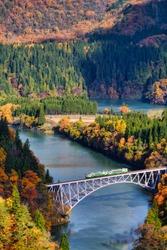 Aerial view of Tadami line - A beautiful autumn landscape, Tadami railway line and Tadami river in morning warm sunlight of autumn, Fukushima, Japan.