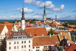 Aerial view of Tallinn old town from Town Hall tower, with Raekoja square, Holy spirit lutheran church, St. Olaf's church, port and Baltic sea