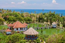 Aerial view of Taman Ujung water palace near Alampura in Karangasem on Bali Island. Ancient palace of Balinese royal family with water pools and tropical landscape park. Indonesian art and culture.